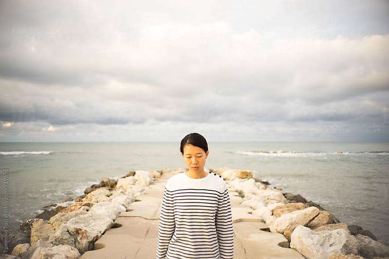 Portrait on the beach by Tommaso Tuzj for Stocksy United