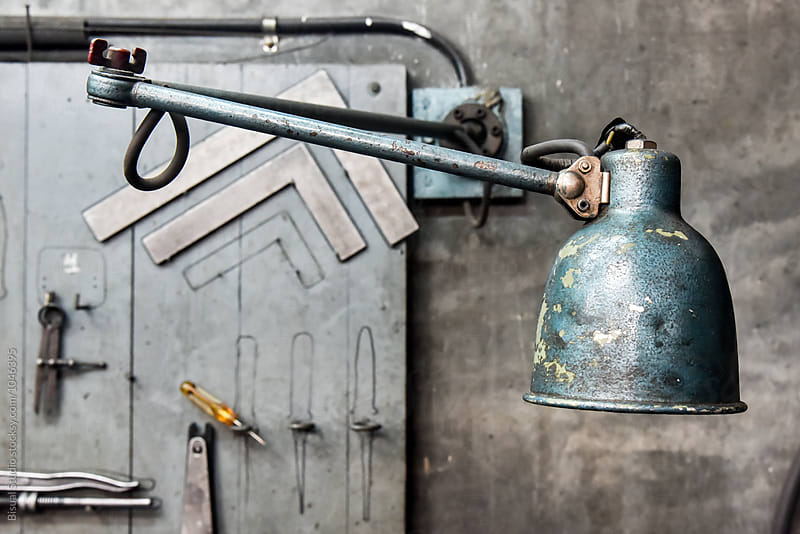 Old iron lamp in a workshop
