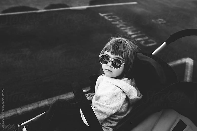 Child in a stroller by Ali Lanenga for Stocksy United