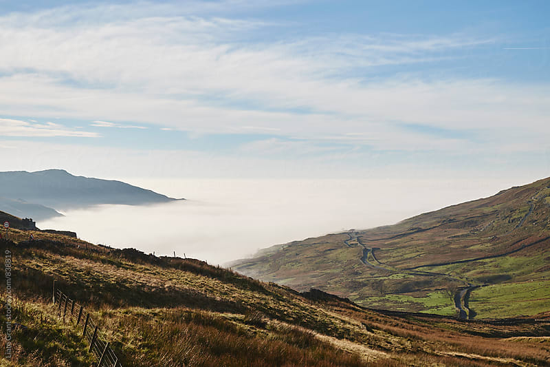 Cloud inversion over Ambleside at sunrise. Cumbria, UK. by Liam Grant for Stocksy United