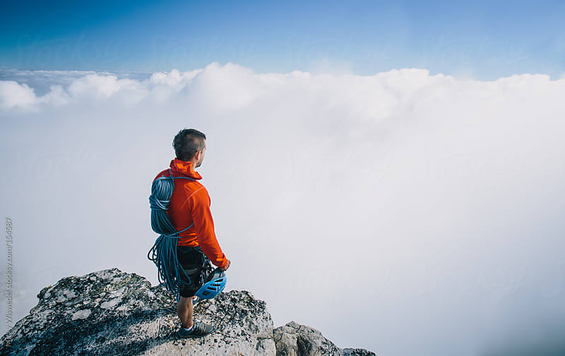 Fit healthy mountaineer overlooking the clouds at the top of  Table Mountain by Micky Wiswedel for Stocksy United