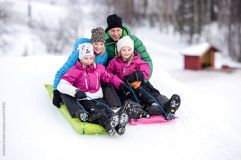 family winter fun by Andreas Gradin for Stocksy United