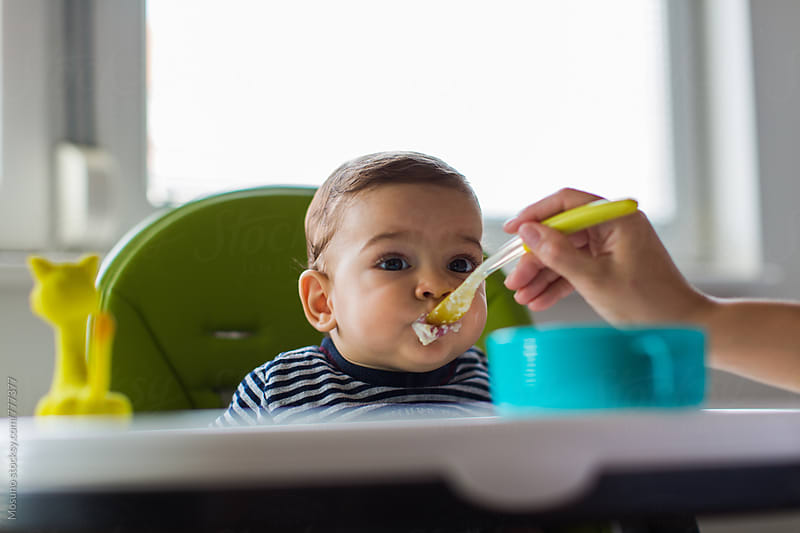 Baby Boy Eating by Mosuno for Stocksy United