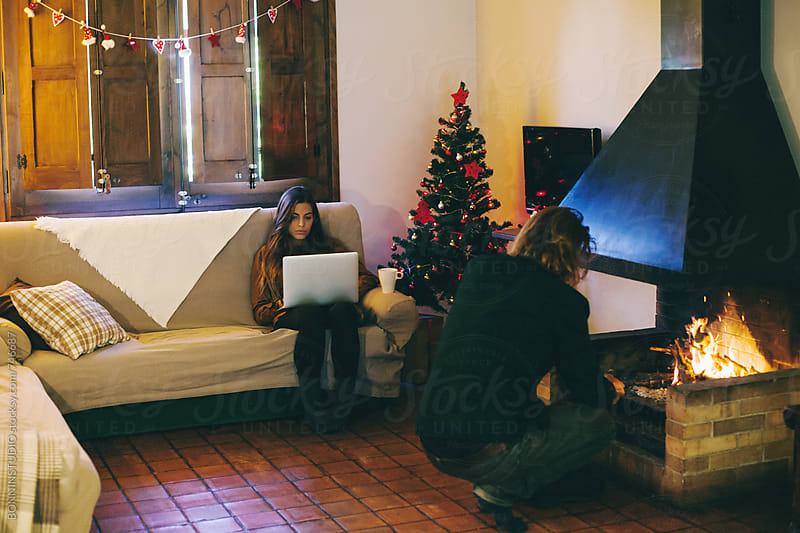 Couple resting in a rural home on winter. by BONNINSTUDIO for Stocksy United