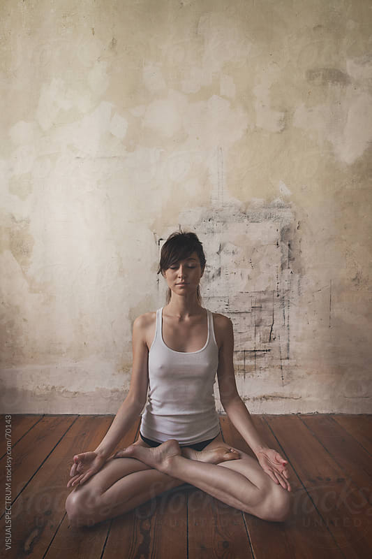 A Woman in Lotus Pose by VISUALSPECTRUM for Stocksy United