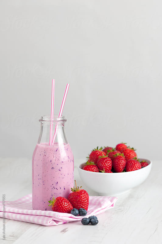 fresh strawberry and blueberry smoothie by Lee Avison for Stocksy United