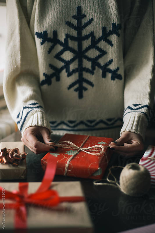 Female hands wrapping Christmas presents  by VeaVea for Stocksy United