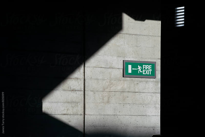 Exit sign  by James Tarry for Stocksy United