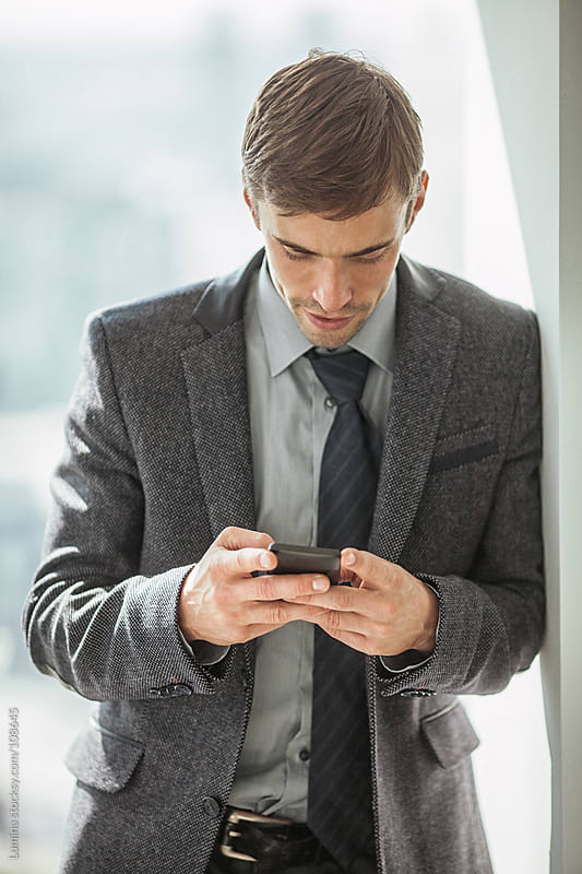 Businessman Texting by Lumina for Stocksy United