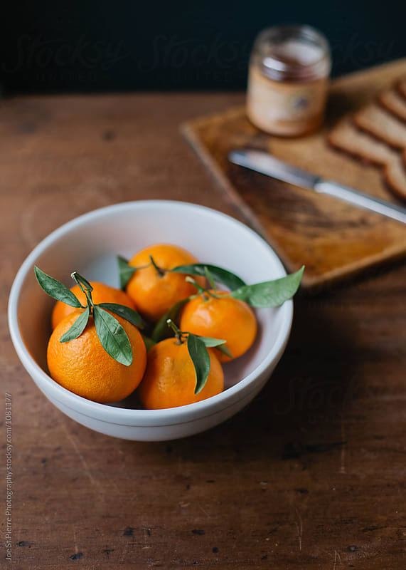 Tangerines or Oranges In A Bowl by Joe St.Pierre Photography for Stocksy United