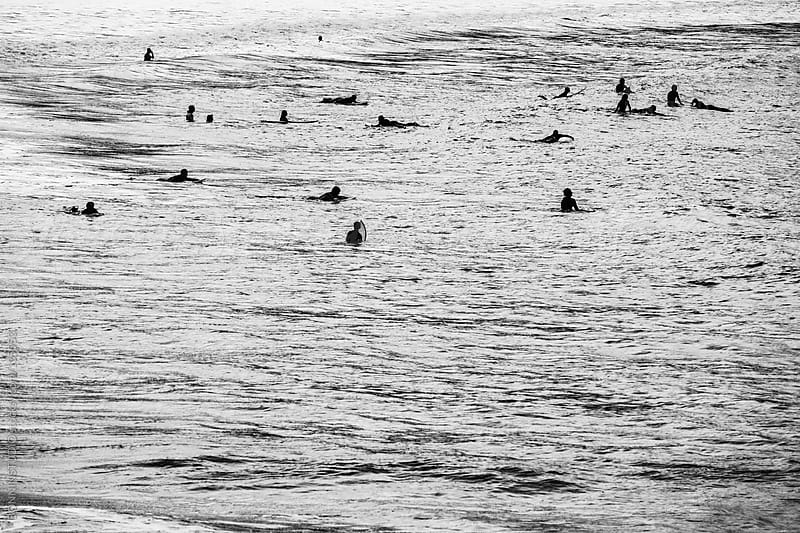 Group of surfers waiting for waves. Black and white photo. by BONNINSTUDIO for Stocksy United