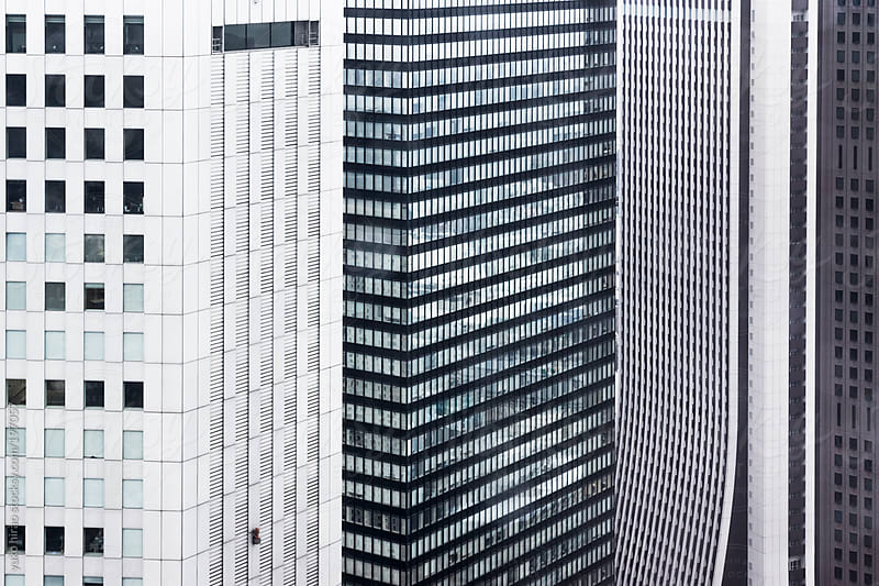 Three skyscrapers standing next to each other by yuko hirao for Stocksy United
