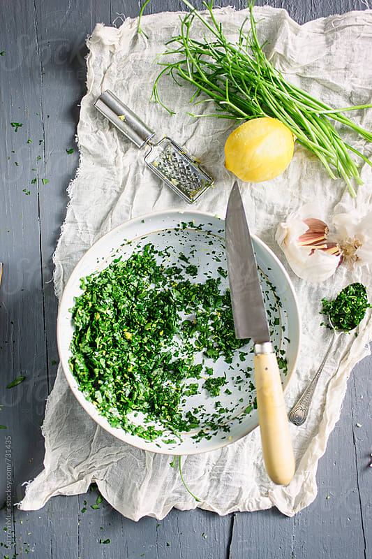 Freshly made gremolata in a bowl on a table. by Darren Muir for Stocksy United