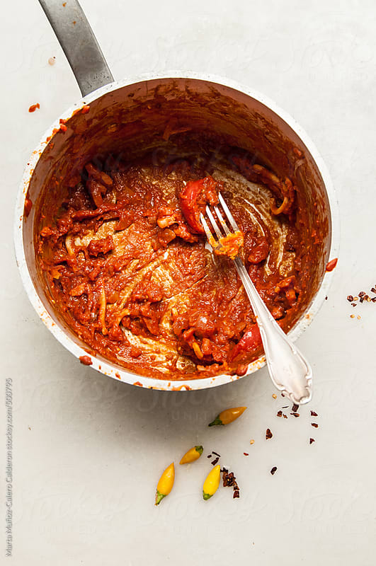 Saucepan with remains of spaghetti with tomato and chile by Marta Muñoz-Calero Calderon for Stocksy United