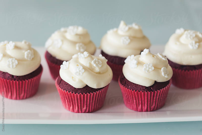 Plate of red velvet cupcakes by Cindy Prins for Stocksy United