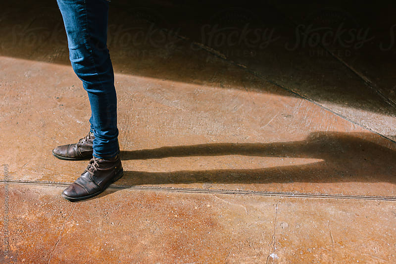 Man Standing in the Street with Brown Boots by VICTOR TORRES for Stocksy United