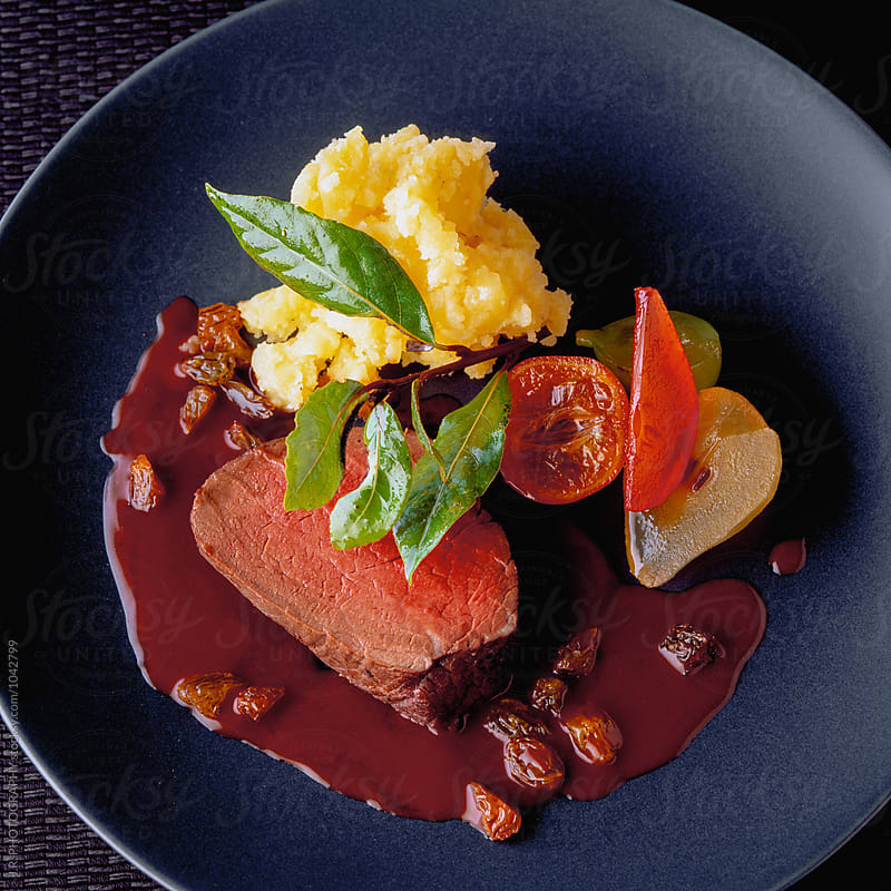 Steak with chocolate sauce by J.R. PHOTOGRAPHY for Stocksy United