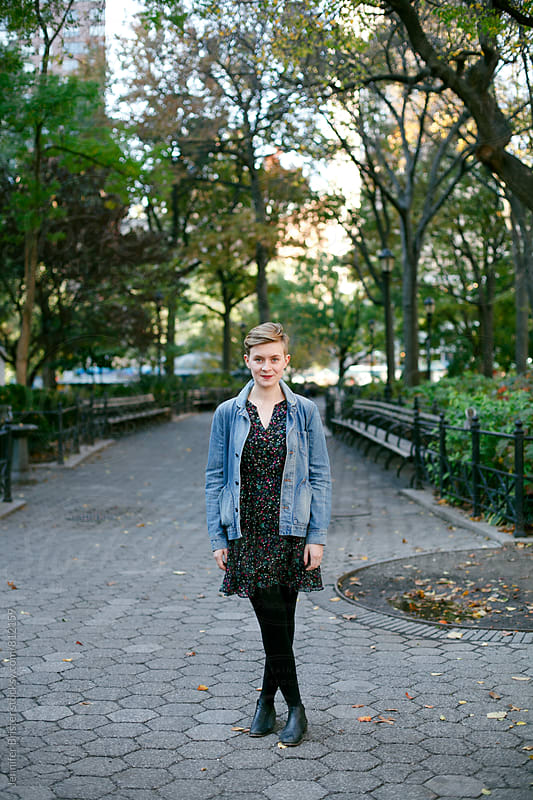 Beautiful, stylish woman standing in park by Jennifer Brister for Stocksy United