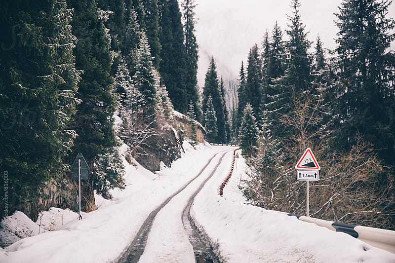 Beautiful photo of snowed road in mountains by Andrey Pavlov for Stocksy United