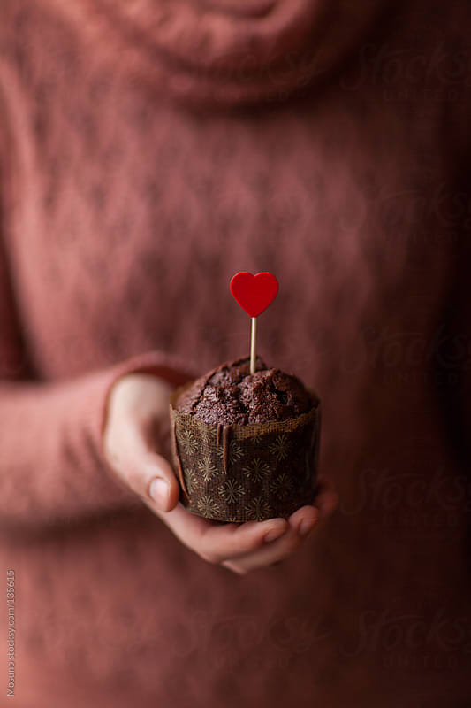 Woman Holding Valentine's Chocolate Muffin by Mosuno for Stocksy United