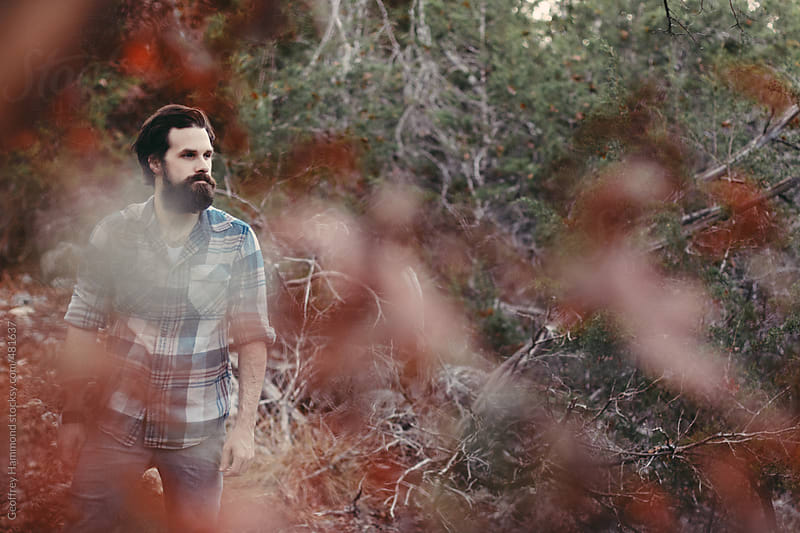 Young Bearded Man Walking in Autumn Forest by Geoffrey Hammond for Stocksy United