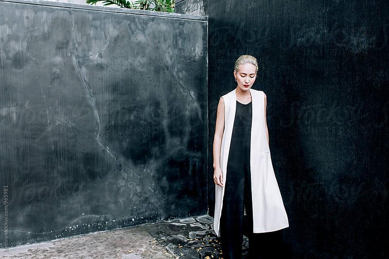 Asian Fashion Model Posing Outdoors by Lumina for Stocksy United