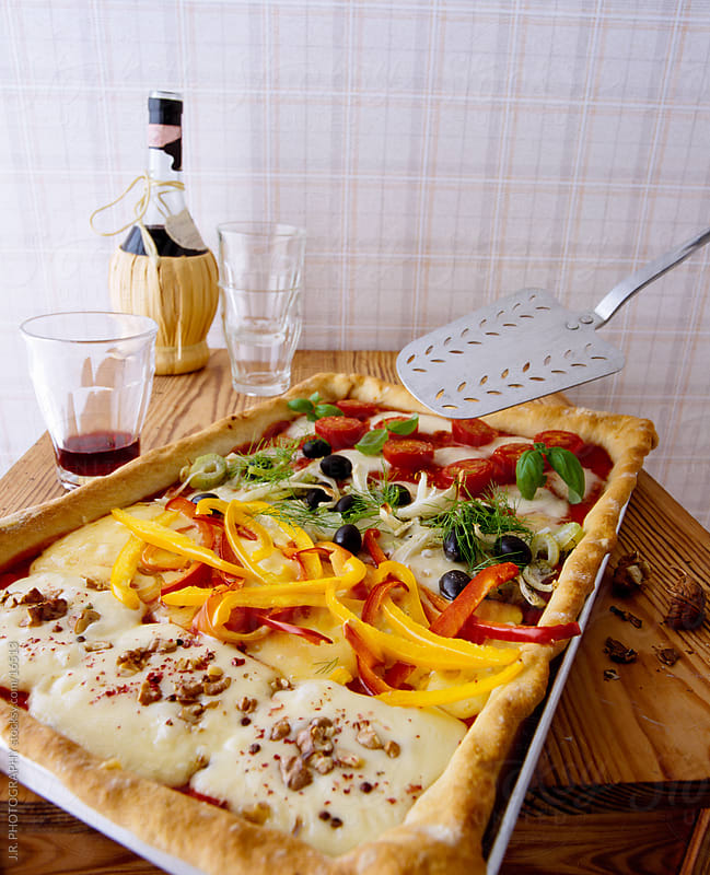 Pizza on a baking tray by J.R. PHOTOGRAPHY for Stocksy United