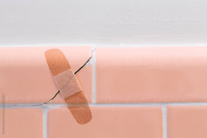 DIY home repair - a bandage on cracked ceramic tile by David Smart for Stocksy United