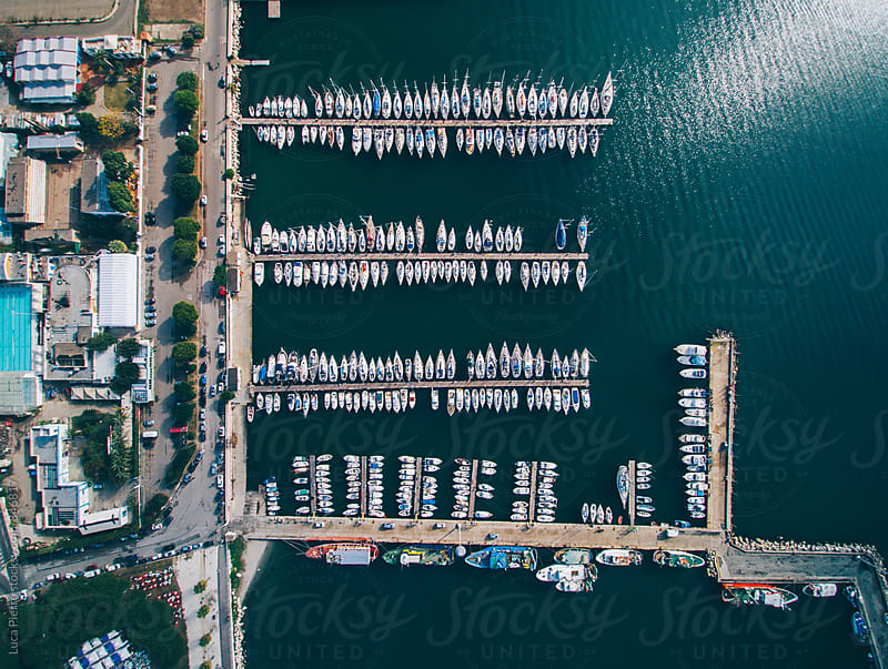 Aerial view of boats docked in a marina. by Luca Pierro for Stocksy United
