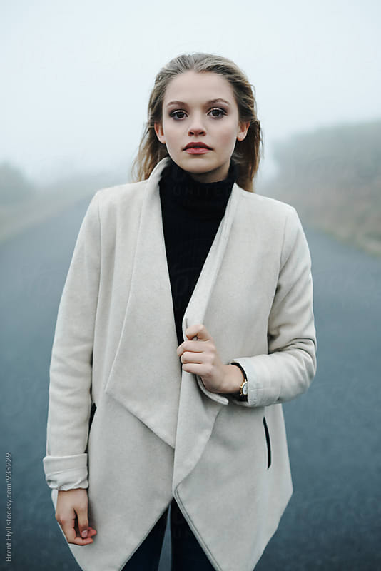 Stylish woman outdoors on a winter's day by Brent Hill for Stocksy United