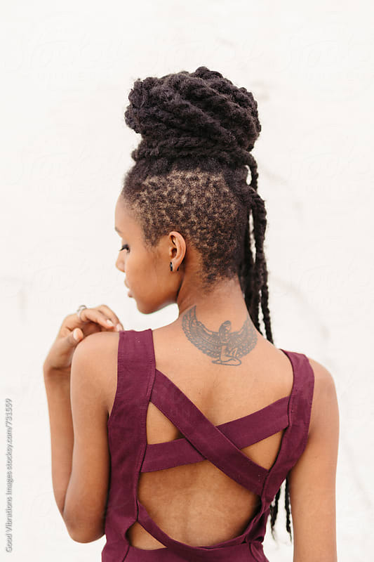 Black woman with dreadlocks by Good Vibrations Images for Stocksy United