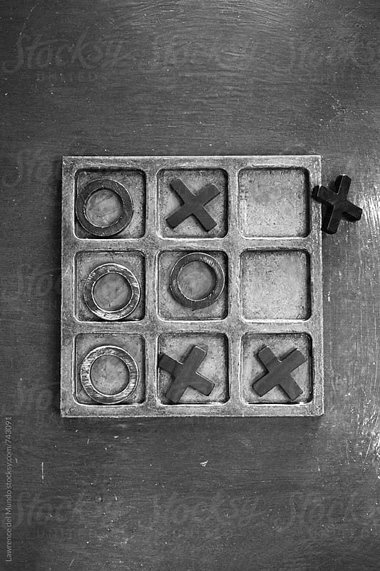 The O wins in a tic tac toe game by Lawrence del Mundo for Stocksy United
