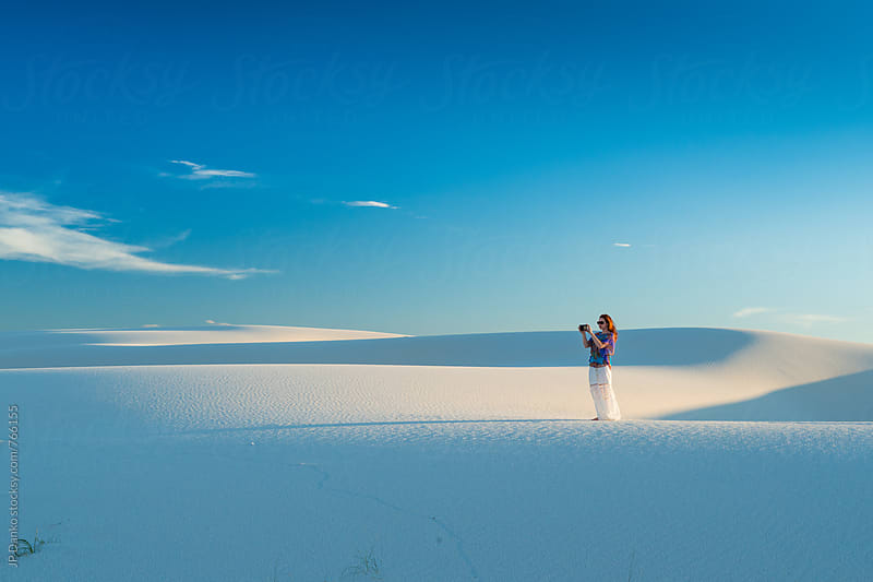 Woman Taking Photo With Mobile Phone of White Sand Dunes In White Sands National Monument New Mexico by JP Danko for Stocksy United