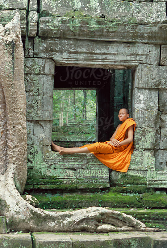 Monk in the Ta Prohm Temple, Angkor, UNESCO World Heritage Site, Siem Reap, Cambodia, Indochina by Gavin Hellier for Stocksy United