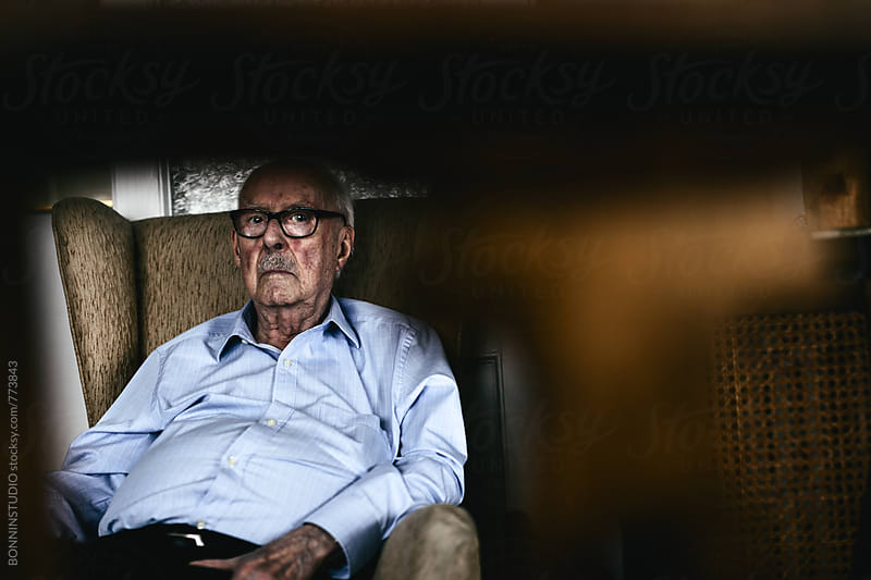 A 96 years old man. Grandfather sitting on a couch at home. by BONNINSTUDIO for Stocksy United