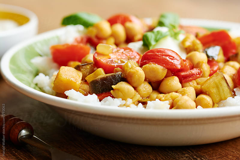 Curried Tomatoes and Eggplant with Chickpeas by Harald Walker for Stocksy United