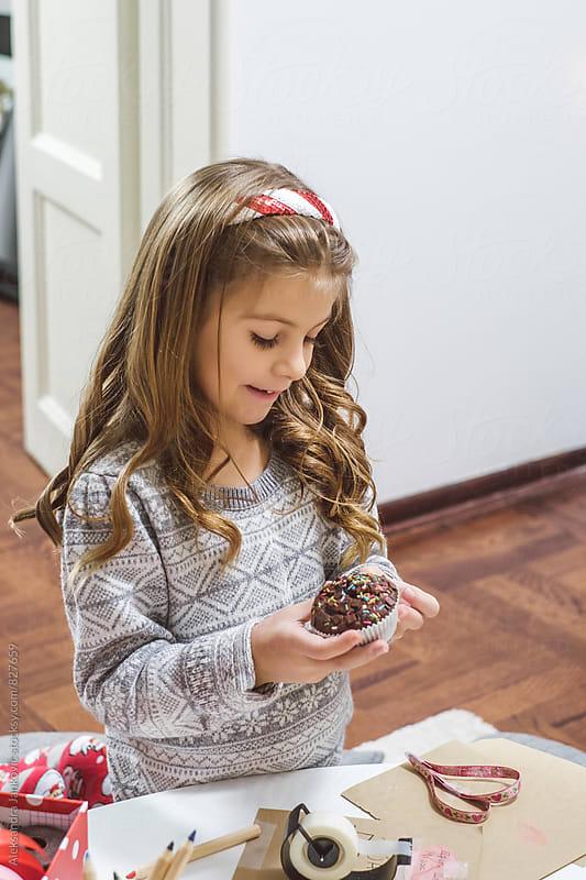 Cute Little Girl Eating Cupcake by Aleksandra Jankovic for Stocksy United