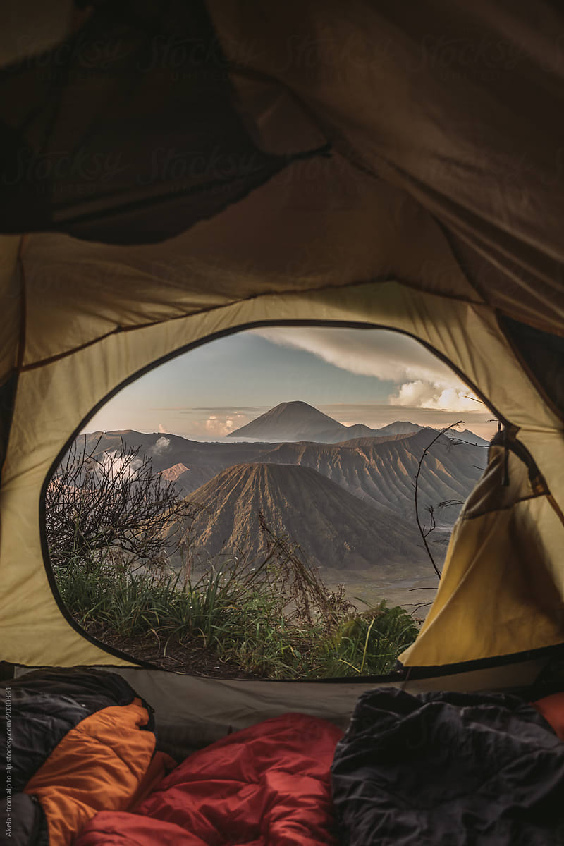 View outside of a tent of mount bromo at sunrise java indonesia by leander