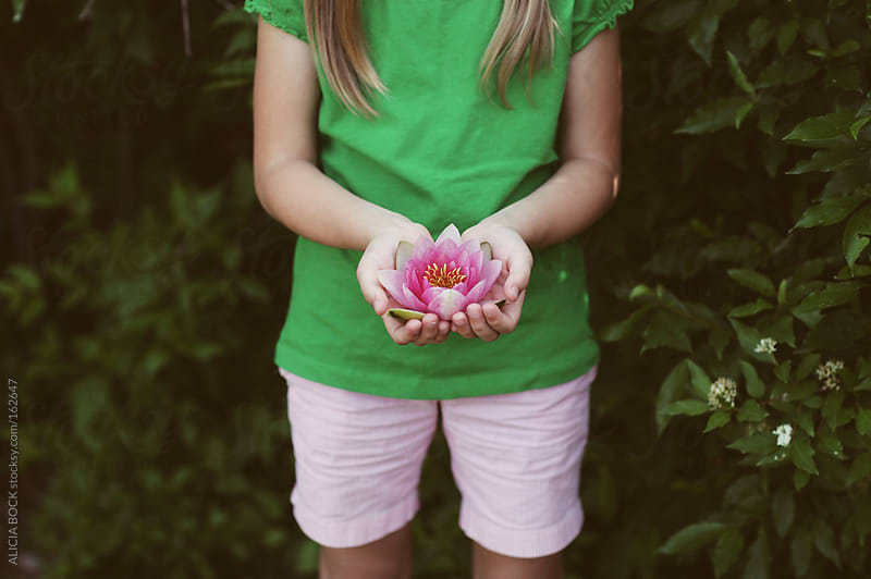 Holding A Water Lily by ALICIA BOCK for Stocksy United