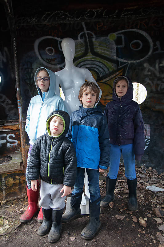 Four kids and a mannequin showing their coolest of cool by Carleton Photography for Stocksy United