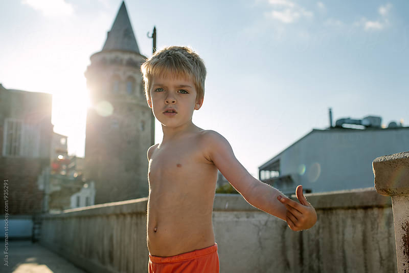 Young boy on an Istanbul rooftop in summer. by Julia Forsman for Stocksy United