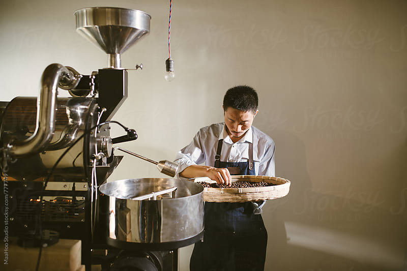 Man working at coffee roasting workshop by Maa Hoo for Stocksy United