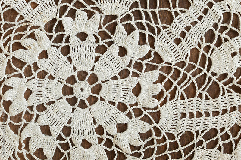 Detail of vintage crochet doily on dark background by David Smart for Stocksy United