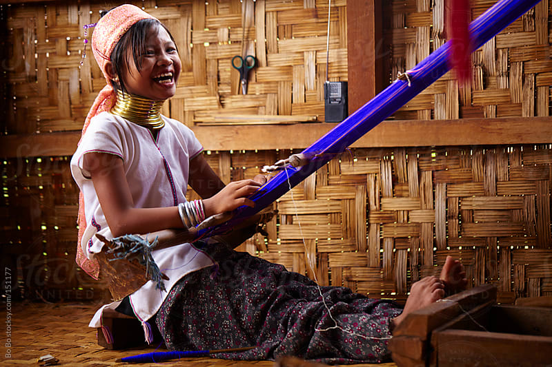 Myanmar long neck girl weaving  by Bo Bo for Stocksy United