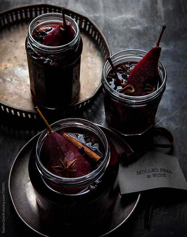 Poached pears in mulled red wine  by Nadine Greeff for Stocksy United