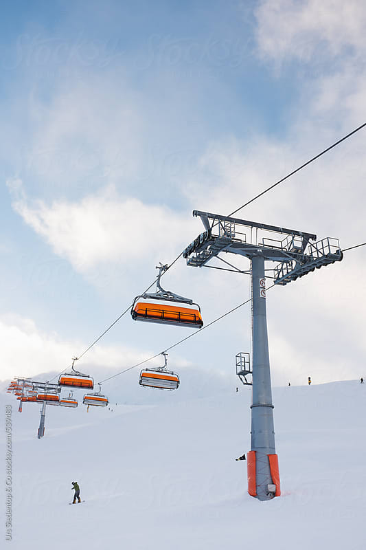 Modern chairlift and skiing slope by Urs Siedentop & Co for Stocksy United