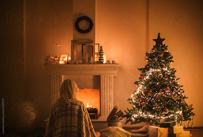 Woman by the Fireplace on Christmas Eve by Lumina for Stocksy United