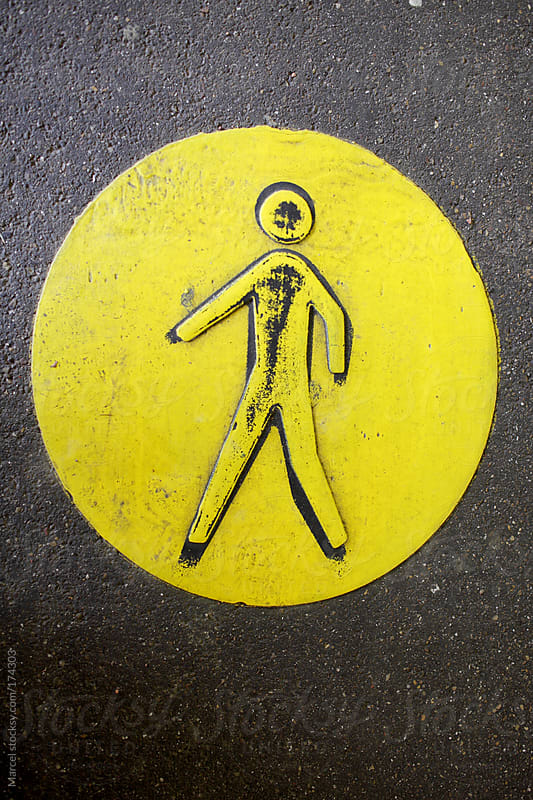 Yellow walking sign by Marcel for Stocksy United