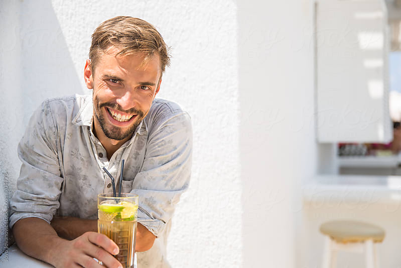 Smiling man looking at the camera by Jovo Jovanovic for Stocksy United