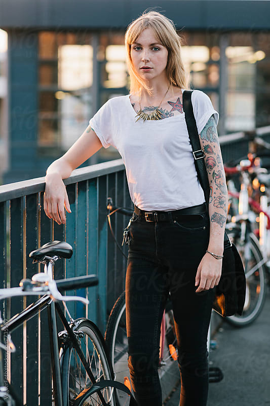 Portrait of young woman with Bicycle by VegterFoto for Stocksy United